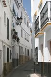 Charming street with white houses, Seville Spain Royalty Free Stock Photos