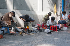 Street Shoe Repairing. Vietnamese shoe repair outdoor in Saigon (Ho Chi Minh Stock Photo