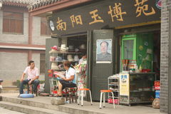 Street shop in China with Mao Tse Tung portrait Stock Photography