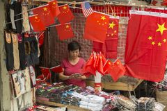 Street shop in Shanghai, Chinai. Street shop with flags and socks in old part of Shanghai, China Stock Photo