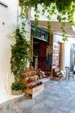 Street shop with ornaments, gift, souvenir in Small cretan village in Crete island, Greece. Building Exterior of home Stock Photos