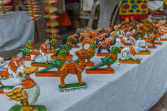 Street shop selling hand made painted ceramic toys of parrot, elephant, horse, rabbit . Chennai India Feb 25 2017 Royalty Free Stock Image