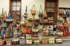 Street shopping. Colourful hadbags display on Eastern City street Stock Photo
