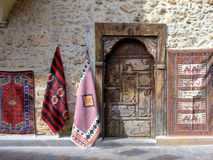 Street shopping. Carved ancient doorway of a shop in an old Mediterranean city Royalty Free Stock Images