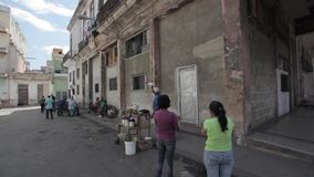 Street shopping in Havana, Cuba. Street shopping in Havana. Usual way is the buyers don`t go at the street but simply throw down rope with a bag and money stock video footage