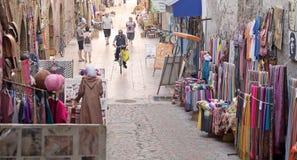 Street shops at the Essaouira. Morocco: street shops in the narrow road at the Essaouira fortified city. Essaouira is a city in the western Moroccan economic stock image
