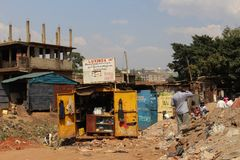 Street and shops in the slums of the capital of Uganda - Kampala stock photography