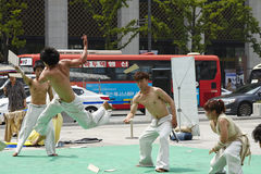 Street show. Korean young men and girl performing judo in the square Stock Image
