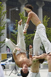 Street show. Korean young men and girl performing judo in the square Stock Photos