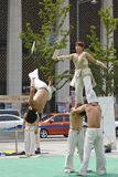 Street show. Korean young men and girl performing judo in the square Stock Photo