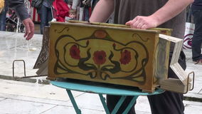 STREET SHOW, musicians playing with vintage barrel organ and singing in Sunday market, MAY 25, 2014 in Par stock video