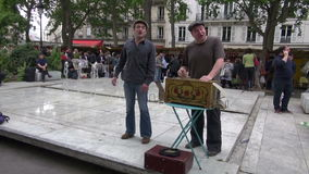 STREET SHOW, musicians playing with vintage barrel organ and singing in Sunday market, MAY 25, 2014 in Par stock video footage