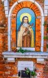 Street Shrine Nun Saint Mosaic Venice Italy. Italian Words Say for the Poor Saint Vincenszo de Paoli Stock Image