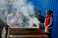 Street side food vendor grills meat skewers Shanghai China Stock Photography