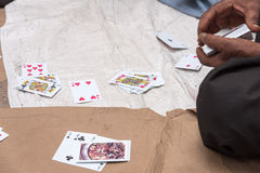 Street side Gambling. People playing cards during leisure time royalty free stock images