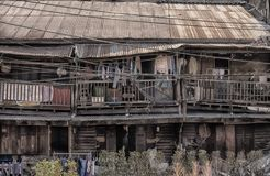 The street side old house near the Flower market in Bangkok,many people are there. stock image