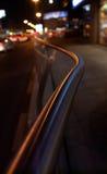 Street and sidewalk at night. Railing between street and sidewalk at night stock photos