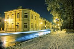 Street in Siedlce, Poland. Covered with snow at night Stock Photos