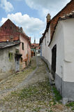 Street in Sighisoara medieval city, Romania Stock Images