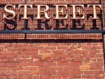 Street Sign. A three-dimensional metal STREET sign in a serif typeface royalty free stock photography