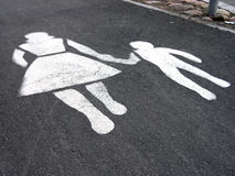 Street sign. Painted traffic sign on asphalt - mother and child, pedestrians' way Royalty Free Stock Image