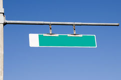 Street Sign. Blank green street sign on horizontal pole with blue sky Royalty Free Stock Photo