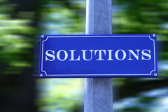 Street Sign. Which says Solutions Stock Images