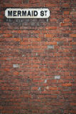Street sign wall background mermaid st rye uk Royalty Free Stock Image