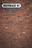 Street sign wall background mermaid st rye uk royalty free stock image