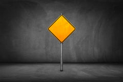 Street Sign: blank yellow road sign with street wall.  royalty free stock image