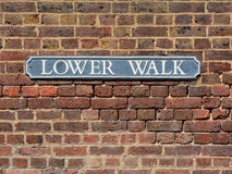 Street sign on a brick wall for Lower Walk in The Pantiles Stock Photography