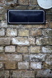 Street sign on a brick wall Stock Image