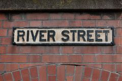 Street sign in Bristol. Detailed shot on a brick wall royalty free stock images