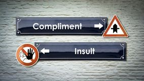 Street Sign Compliment versus Insult. Street Sign the Direction Way to Compliment versus Insult royalty free stock images