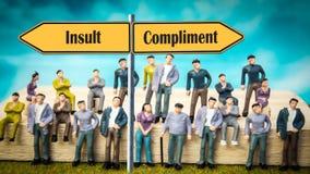 Street Sign Compliment versus Insult. Street Sign the Direction Way to Compliment versus Insult stock images