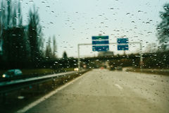 Street sign dangerous driving during heavy rain Stock Photo