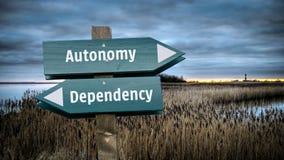 Street Sign to Autonomy versus Dependency. Street Sign the Direction Way to Autonomy versus Dependency stock image