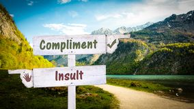 Street Sign Compliment versus Insult. Street Sign the Direction Way to Compliment versus Insult royalty free stock image
