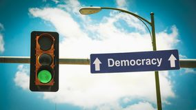 Street Sign to Democracy. Street Sign the Direction Way to Democracy royalty free stock photo
