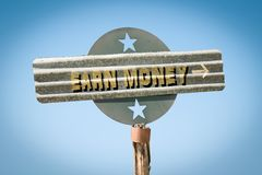 Street Sign Earn Money. Street Sign the Direction Way to Earn Money stock images