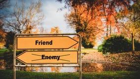Street Sign to Friend versus Enemy. Street Sign the Direction Way to Friend versus Enemy stock image