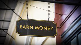 Street Sign Earn Money. Street Sign the Direction Way to Earn Money stock photography