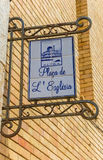 Street sign on the facade of the church in Altea Stock Photos
