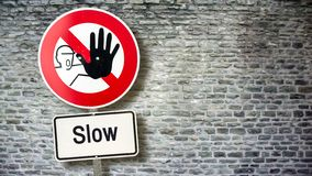 Street Sign Fast versus Slow. Street Sign to Fast versus Slow stock photography