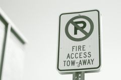 Street sign Fire Access tow Away No Parking stock image