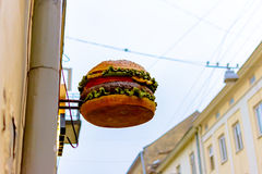 Street sign in the form of big Mac. Lviv, Ukraine - october 22, 2016: Street sign in the form of big Mac Royalty Free Stock Photography
