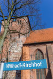 Street sign in front of the Wilhadi church in Stade Royalty Free Stock Image