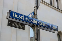 Street sign of the Geschwister-Scholl-Platz in Munich, Germany,. Street sign of the Geschwister-Scholl-Platz Siblings Scholl Plaza in front of the main building Stock Photos