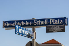 Street sign of the Geschwister-Scholl-Platz in Munich, Germany,. Street sign of the Geschwister-Scholl-Platz Siblings Scholl Plaza in front of the main building Royalty Free Stock Photo
