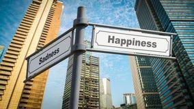 Street Sign Happiness versus Sadness. Street Sign the Direction Way to Happiness versus Sadness stock photos